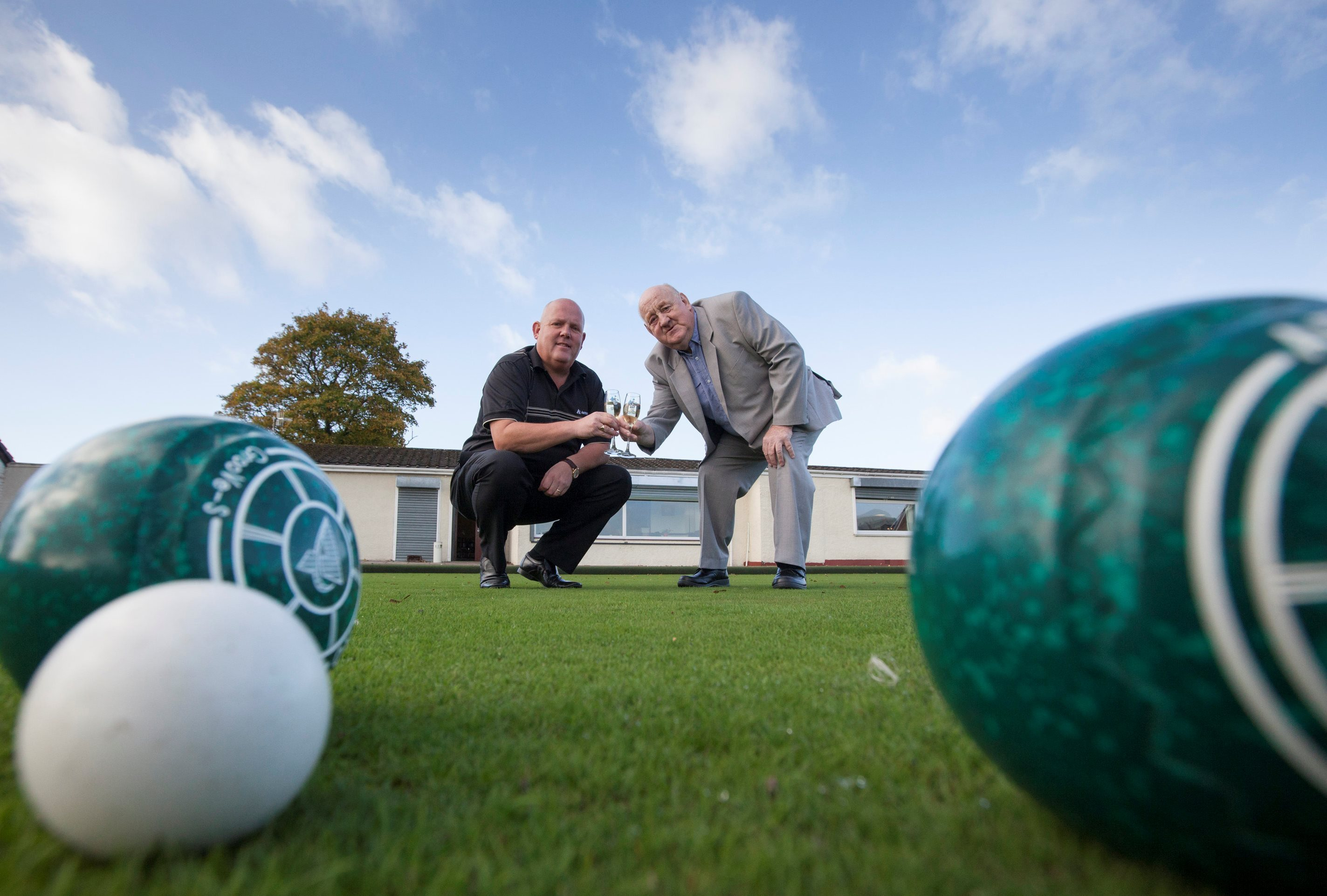 James Roy, right, from Shotts, North Lanarkshire, celebrating winning £1 million on the National Lottery with bowling legend Alex Marshall.