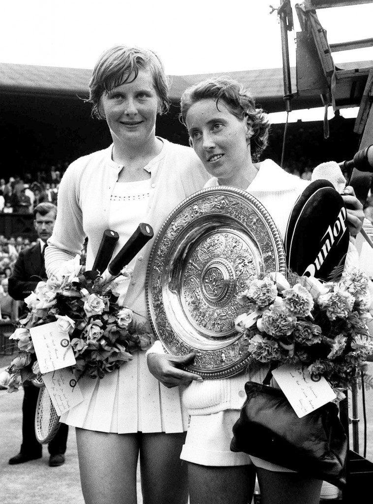 Beaten but smiling, Christine Truman puts a friendly arm around Angela Mortimer, first British winner of the title since 1937 (PA Archive)