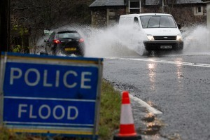 Baby, mother and OAP rescued from cars stuck in Dumfries and Galloway flood water