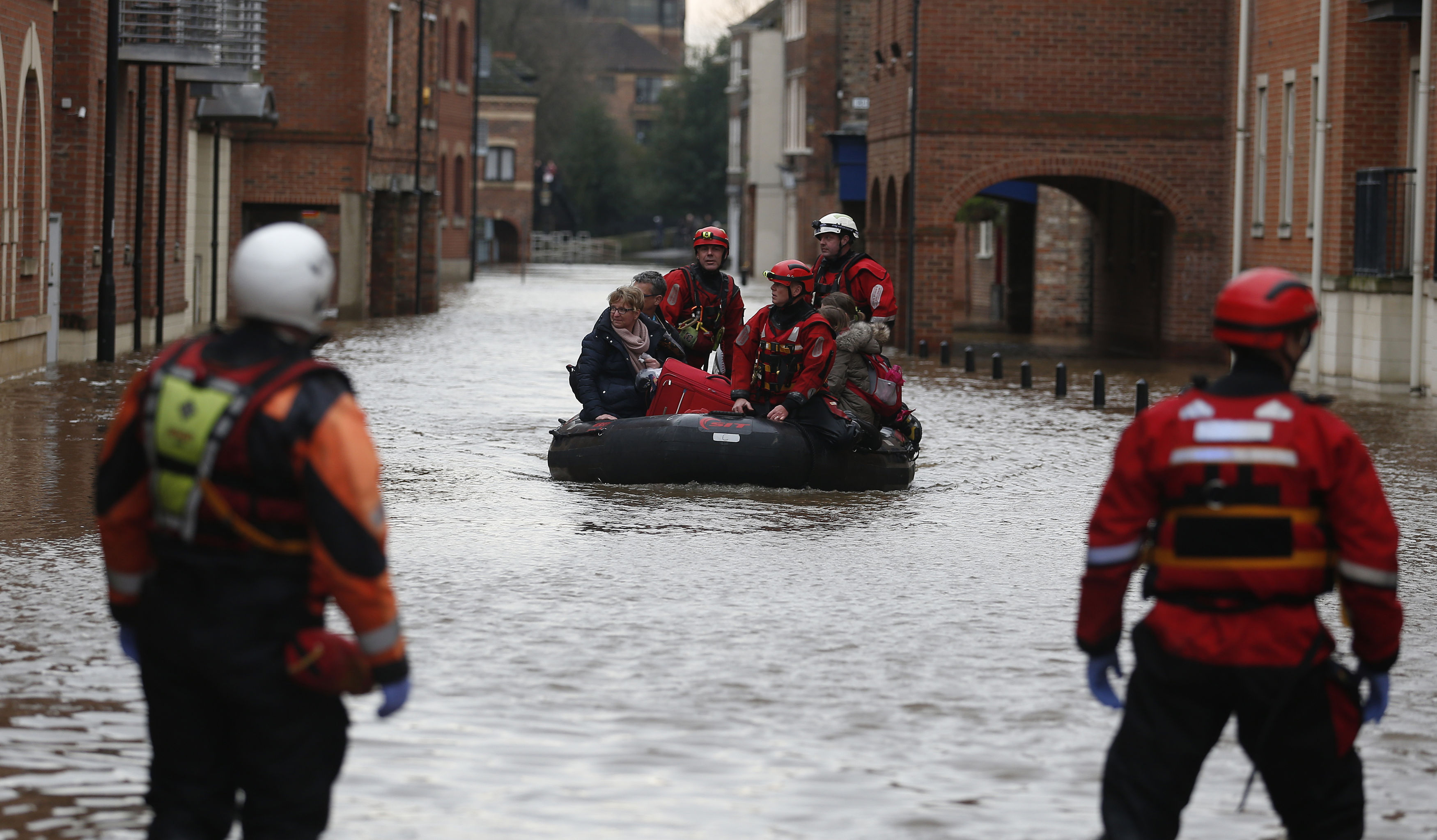 A family is rescued from the centre of York by boat (Owen Humphreys / PA Wire)