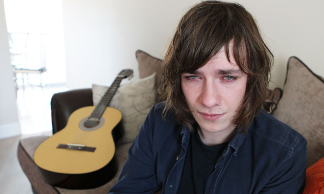 Blinded by bleach thug for playing the guitar - Sunday Post