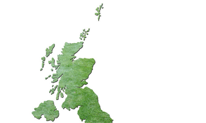 Map of Britain with cut grass background on white