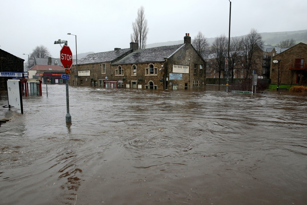 The River Calder bursts its banks in the Calder Valley town of Mytholmroyd on December 26 (Christopher Furlong / Getty Images)