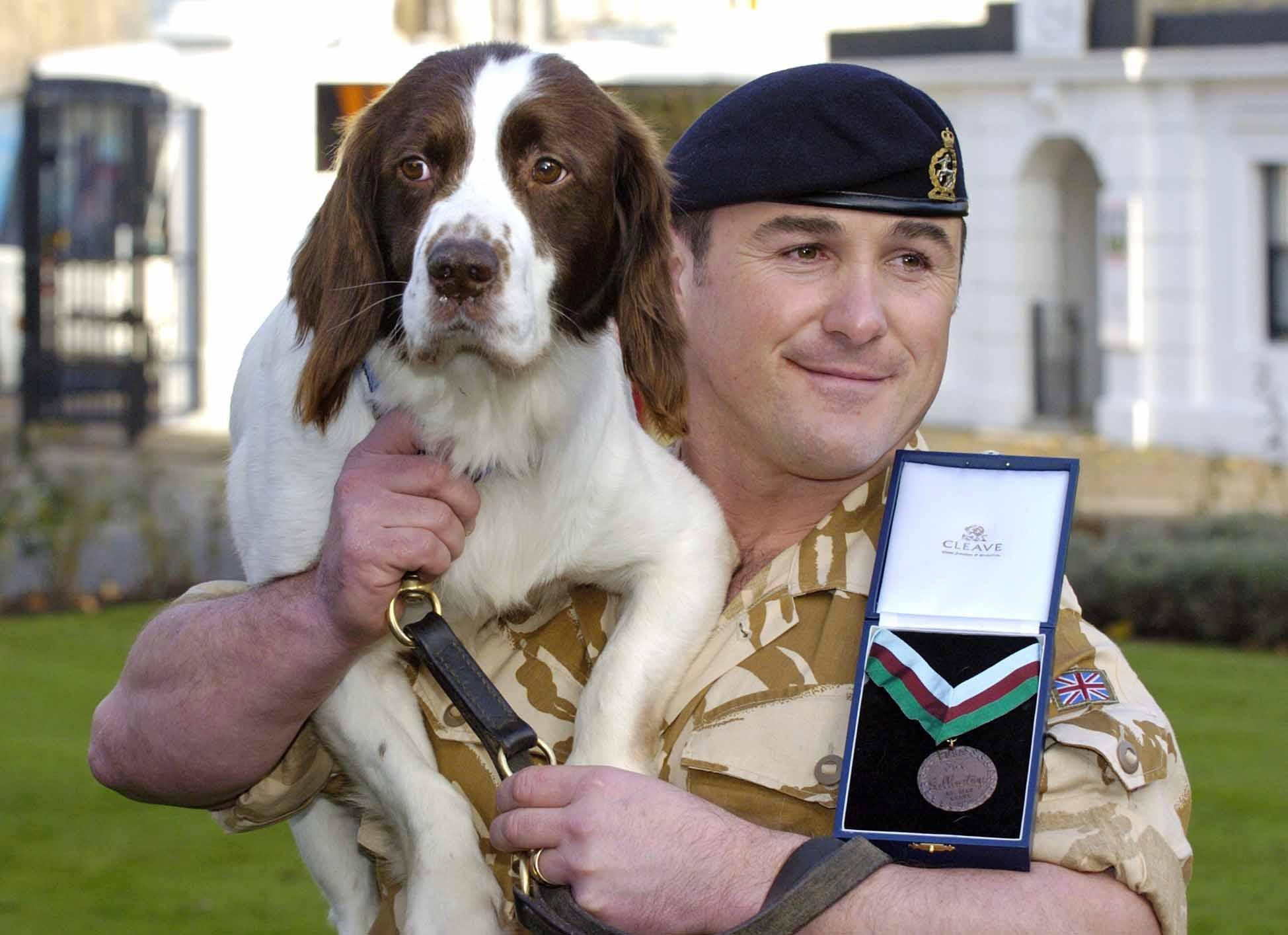 British Army dog Buster with his handler Sgt Danny Morgan (PA Archive)