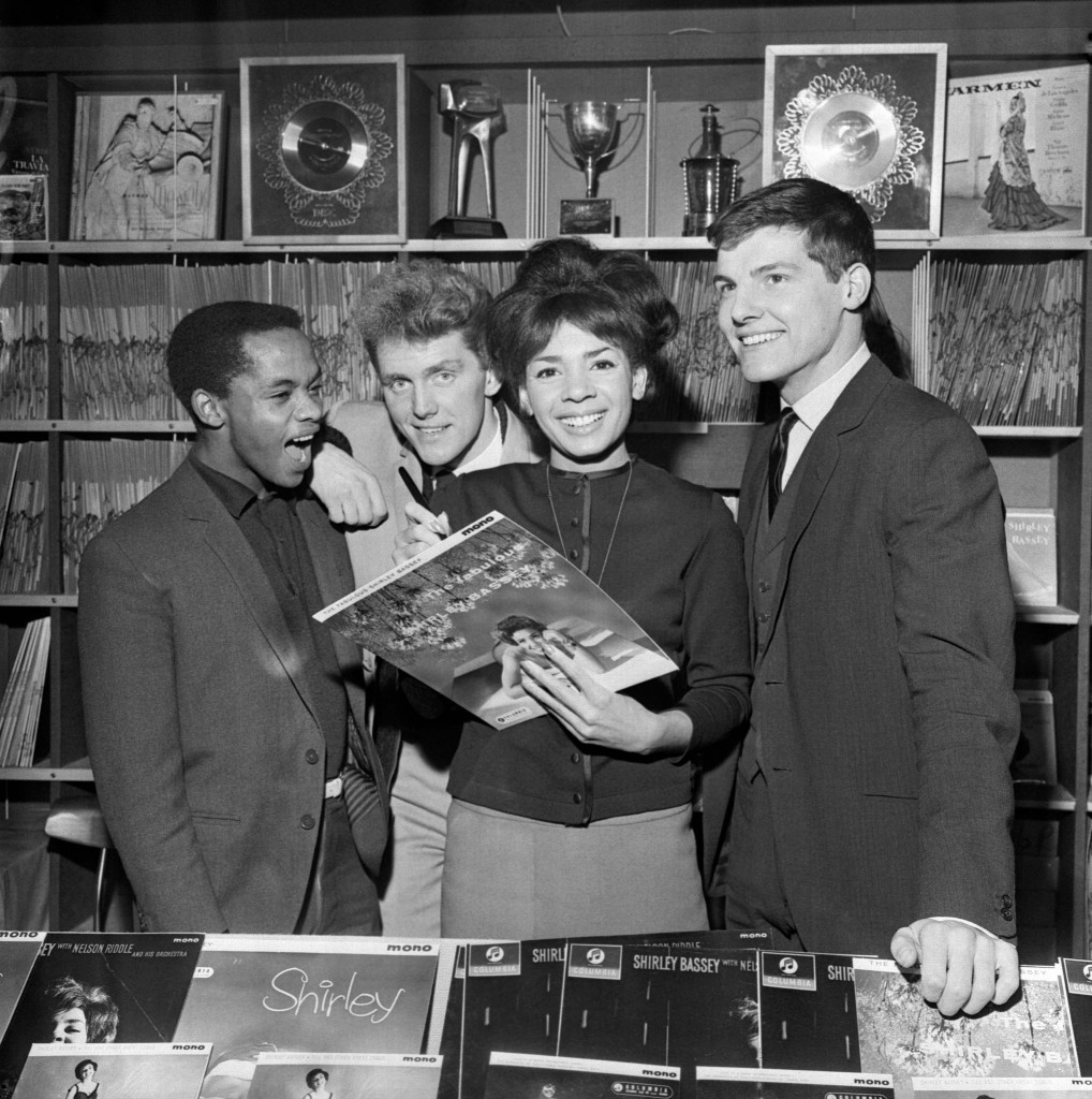 Autographing records at the opening of the Shirley Bassey Record Shop with Danny Williams, Alvin Stardust and Jess Conrad in 1962 (PA Archive)