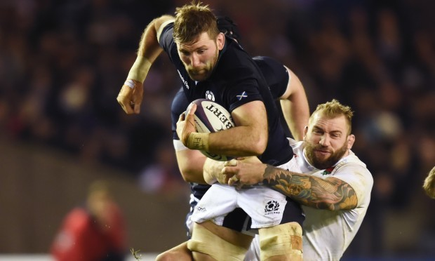 Scotland's John Barclay weathers a tackle (SNS Group/SRU)
