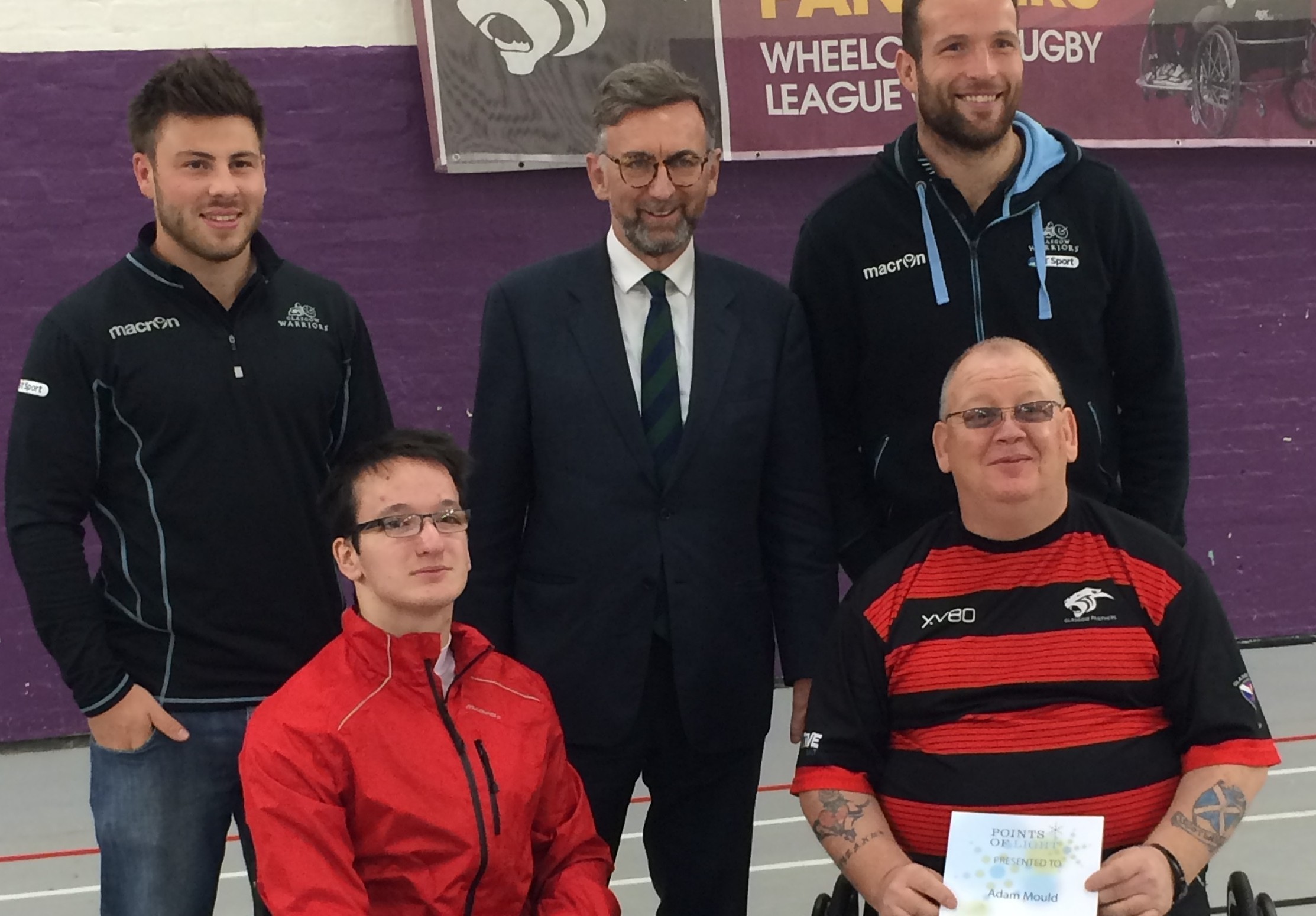Adam (front right) with former Panthers player Sean Frame (front left), Lord Dunlop (back centre) and Glasgow Warriors players James Eddie and Ali Price.