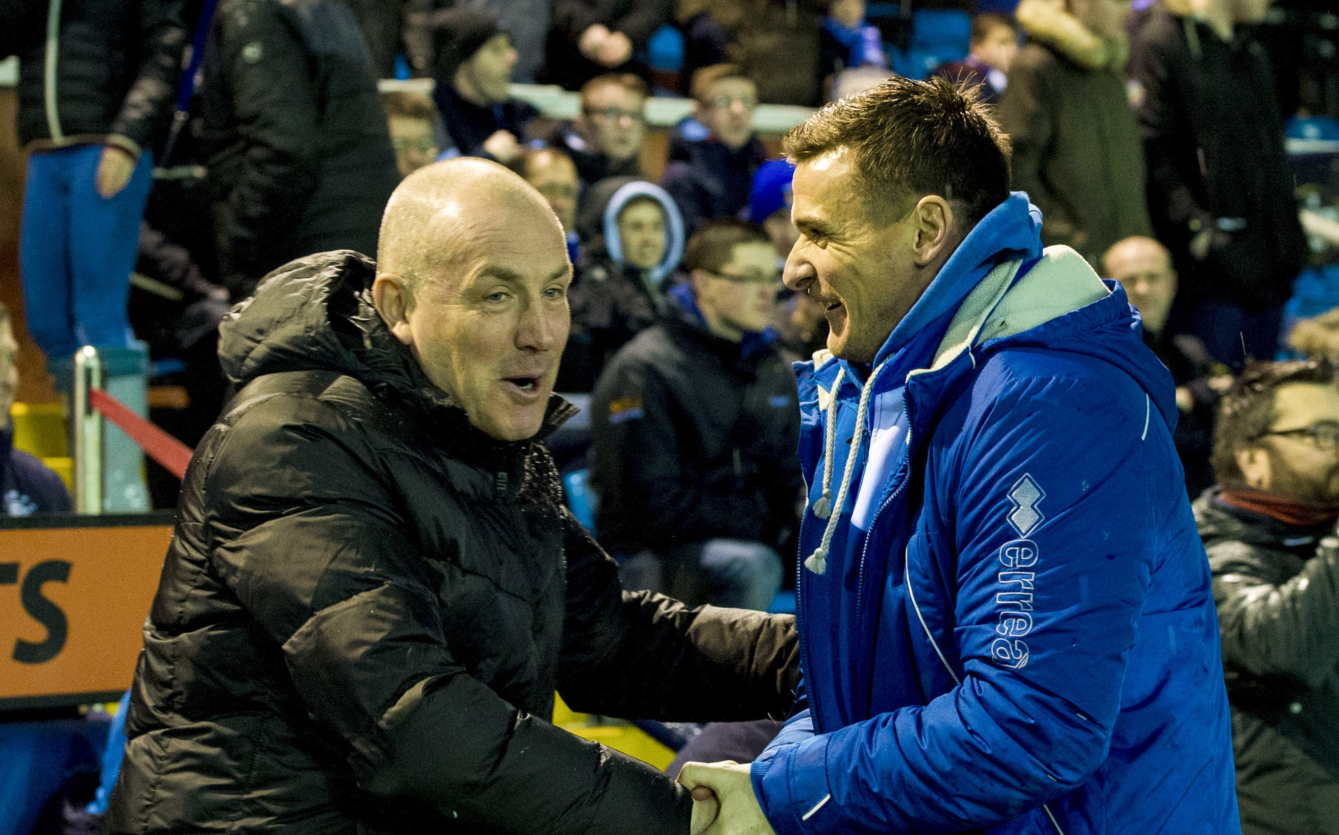 Rangers Manager Mark Warburton (left) shakes hands with Kilmarnock Assistant Lee McCulloch (SNS Group)