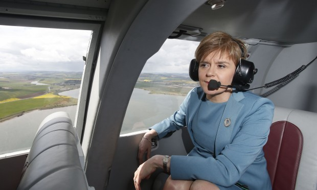 First Minister Nicola Sturgeon in a helicopter on the General Election campaign trail (Danny Lawson / PA)