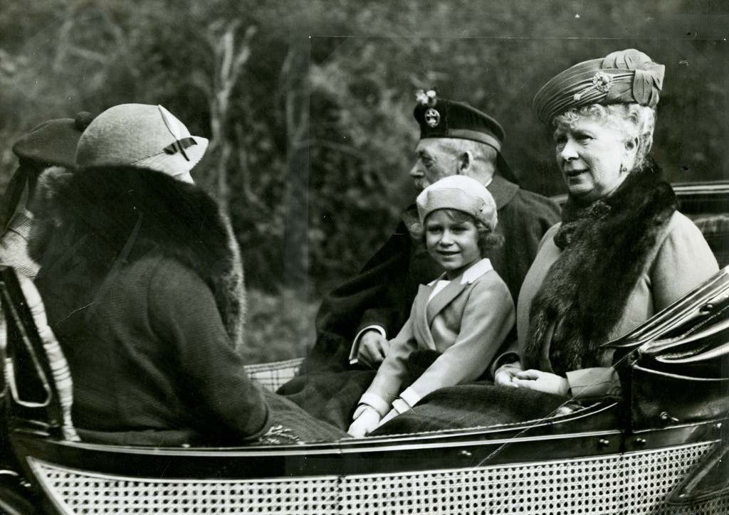 Wrapped up for a Scottish day out with her grandparents, King George V and Queen Mary (DC Thomson)