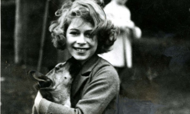 The Queen would become well known for her love of dogs, and as this picture of her aged 12 at Glamis shows, she has been a fan since childhood.