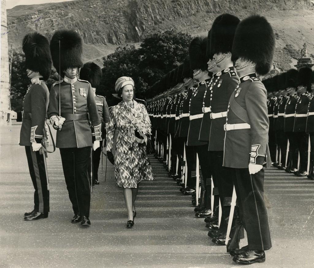 The Queen inspects the impressive guard of honour, the 2nd Battalion Scots Guards, at Holyrood in 1974. Note the slopes of Arthur's Seat in the background (DC Thomson)