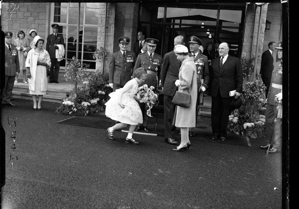 A familar sight as the Queen is presented with a bouquet by a curtseying young Scottish lass in 1961 (DC Thomson)