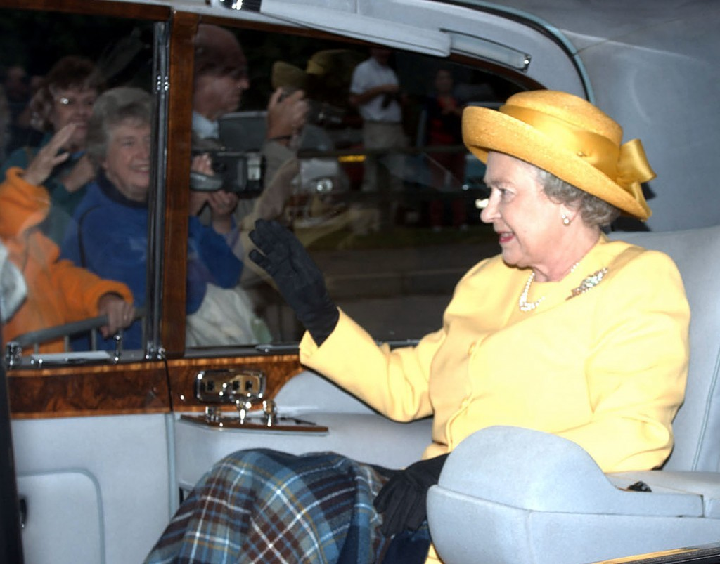 Queen Elizabeth waves to wellwishers as she arrives at Crathie Church at Balmoral (PA Archive)