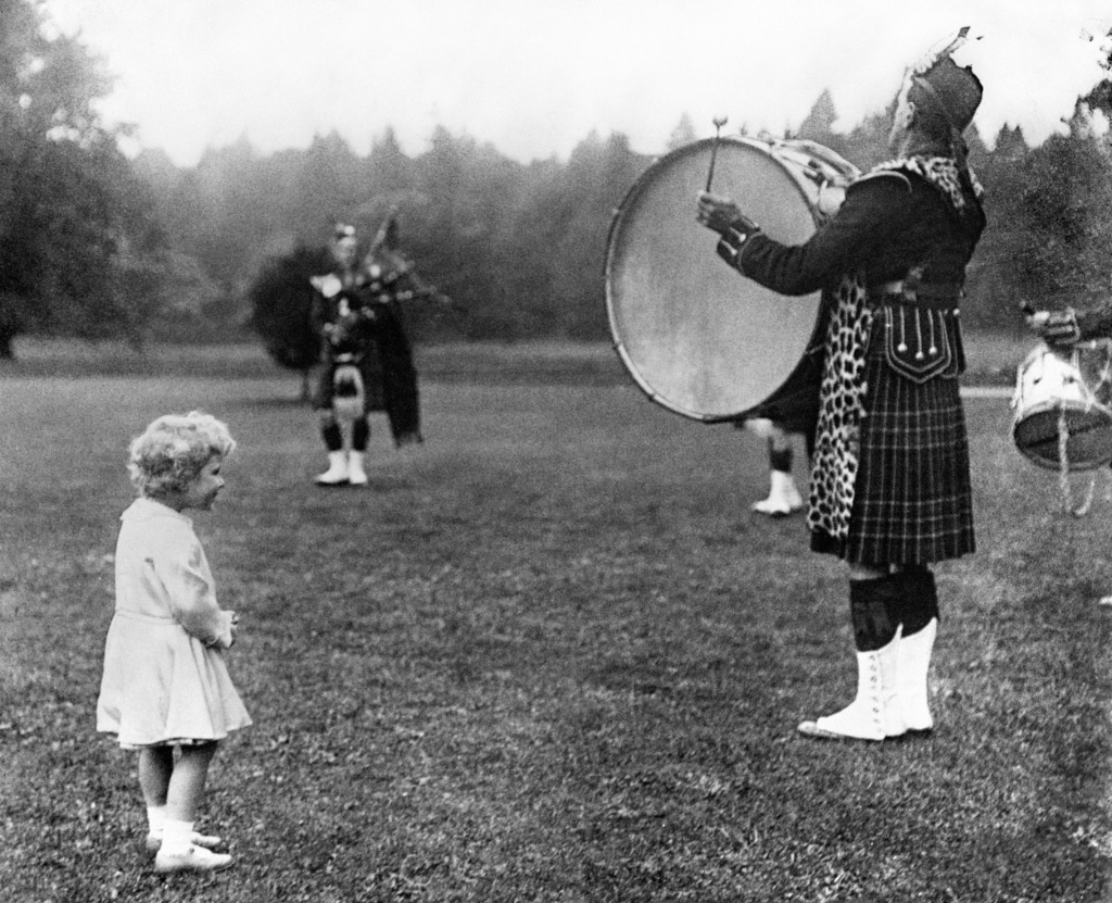Princess Elizabeth is clearly enjoying the sound of the big bass drum during a visit to Scotland in 1929 (DC Thomson)