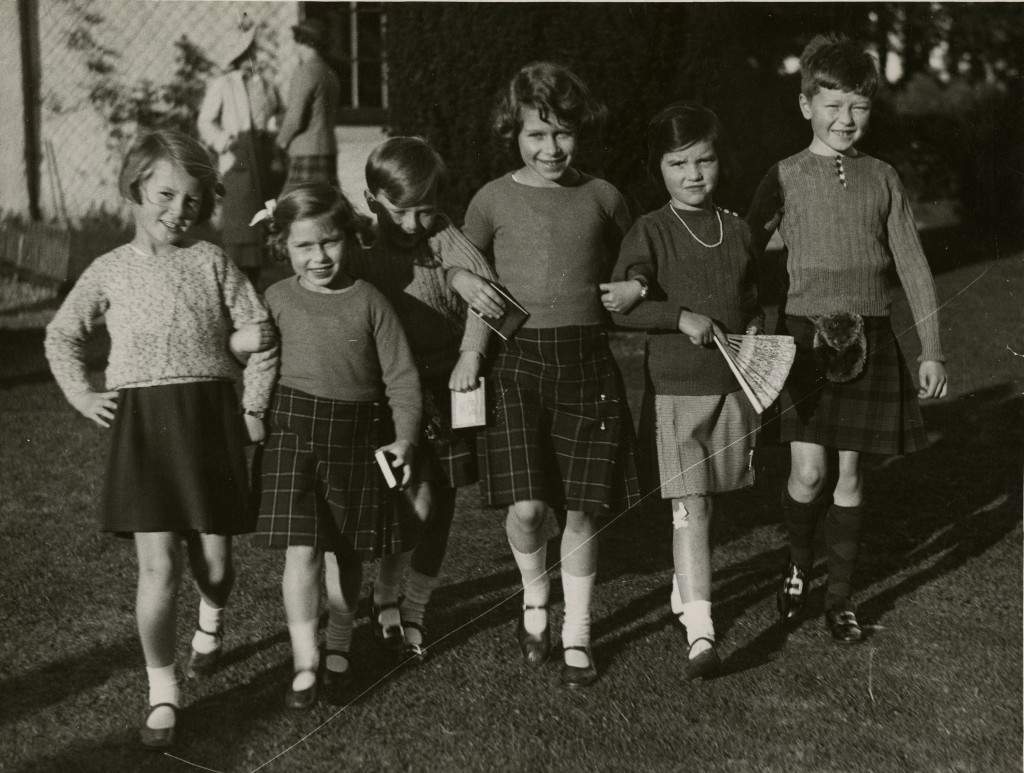 Already showing leadership qualities, the young Princess Elizabeth (centre) takes charge of childhood friends at Elsick House, Newtonhill, near Stonehaven, in 1935 (AJL)
