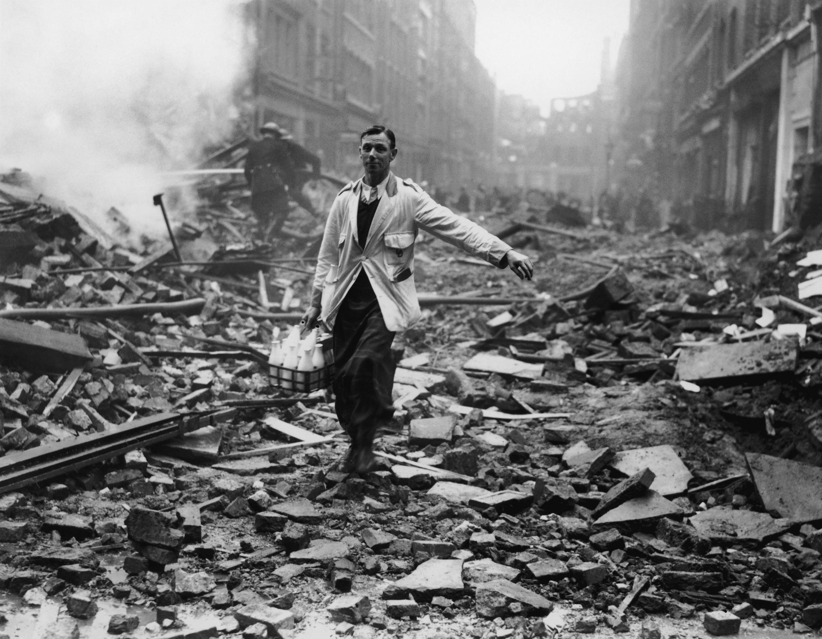 A milkman makes deliveries after a German bomb raid (Fred Morley/Getty Images)