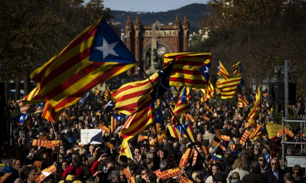 "Pro Independence demonstrators wave ""esteladas"" or pro independence flags, during demonstrations (AP Photo/Emilio Morenatti)1"