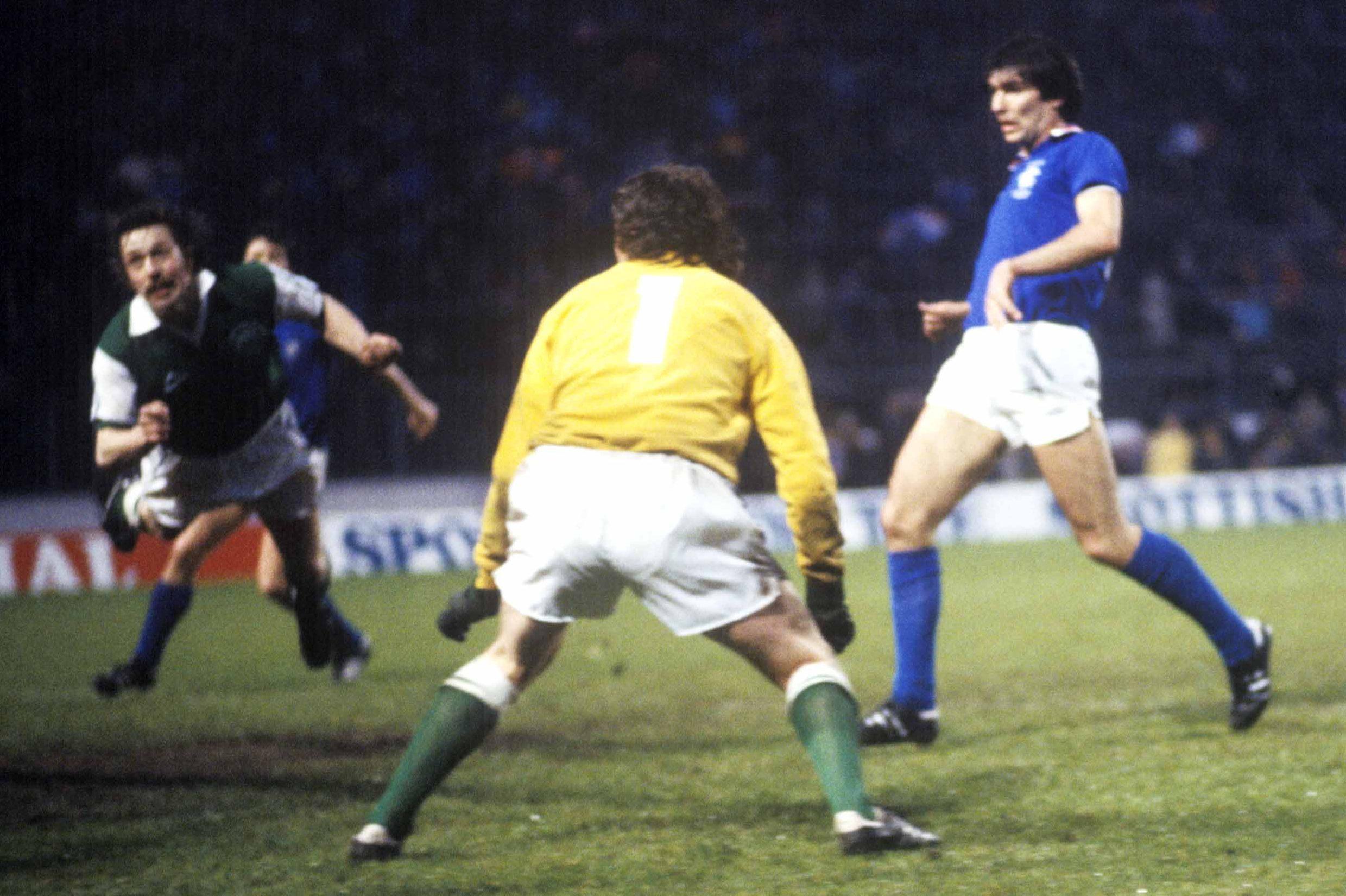 Hibs defender Arthur Duncan (left) inadvertenly heads the ball past goalkeeper Jim McArthur as Rangers striker Gordon Smith looks on, Scottish Cup final replay, 1979