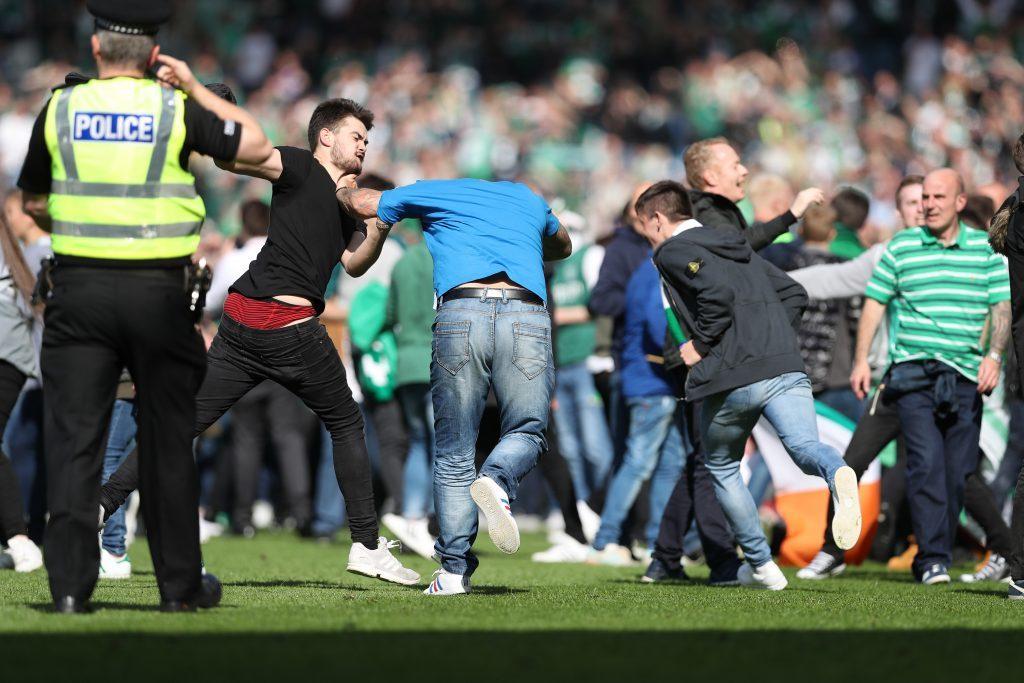 Hibs fans invade the pitch (Ian MacNicol/Getty)