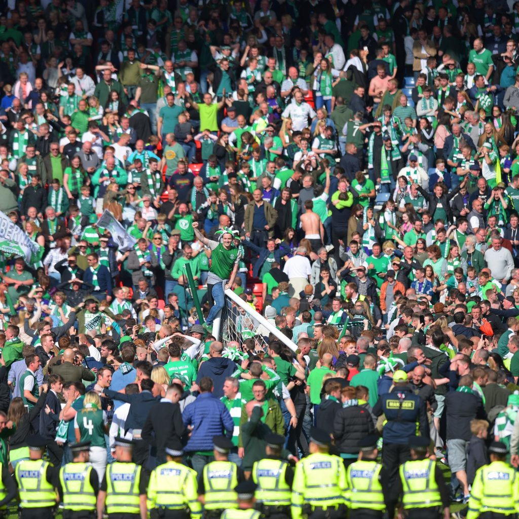 Hibs fans rush the pitch to celebrate their side's historic win (SNS Group)