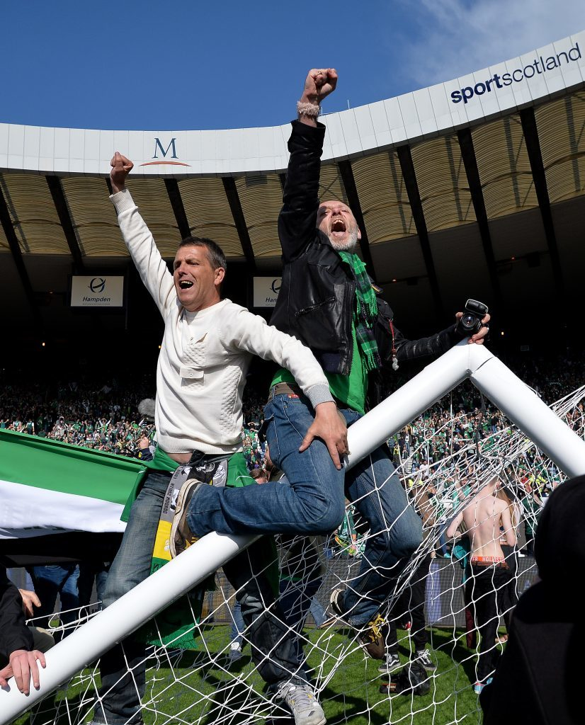 Fans invade the Hampden pitch (Mark Runnacles/Getty Images)