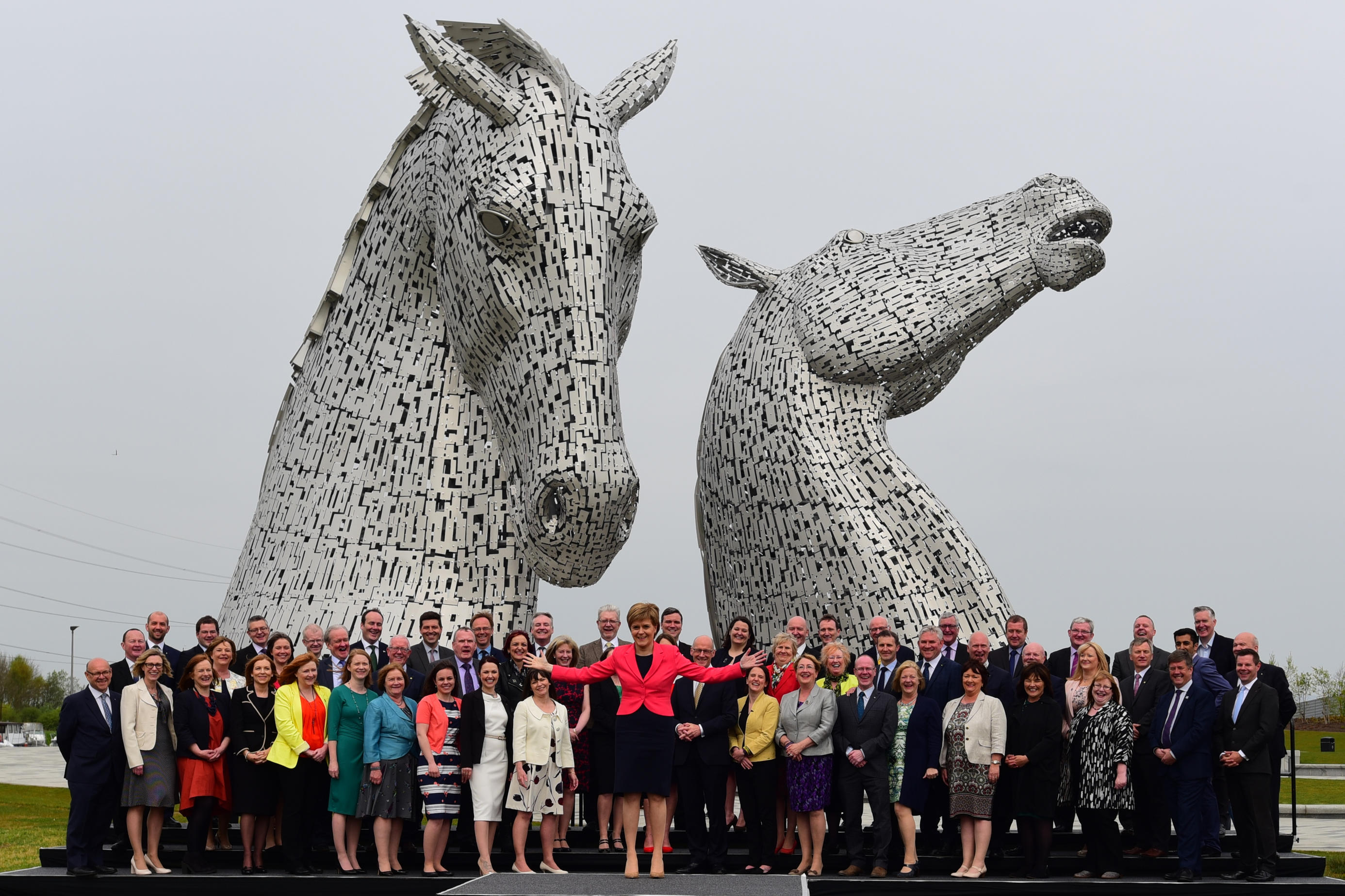 """Scottish First Minister Nicola Sturgeon introduces all 63 new SNP MSPs to the media at a photocall against the the backdrop of """"The Kelpies"""" sculpture in Falkirk (Ken Jack / Alamy Live News)"""