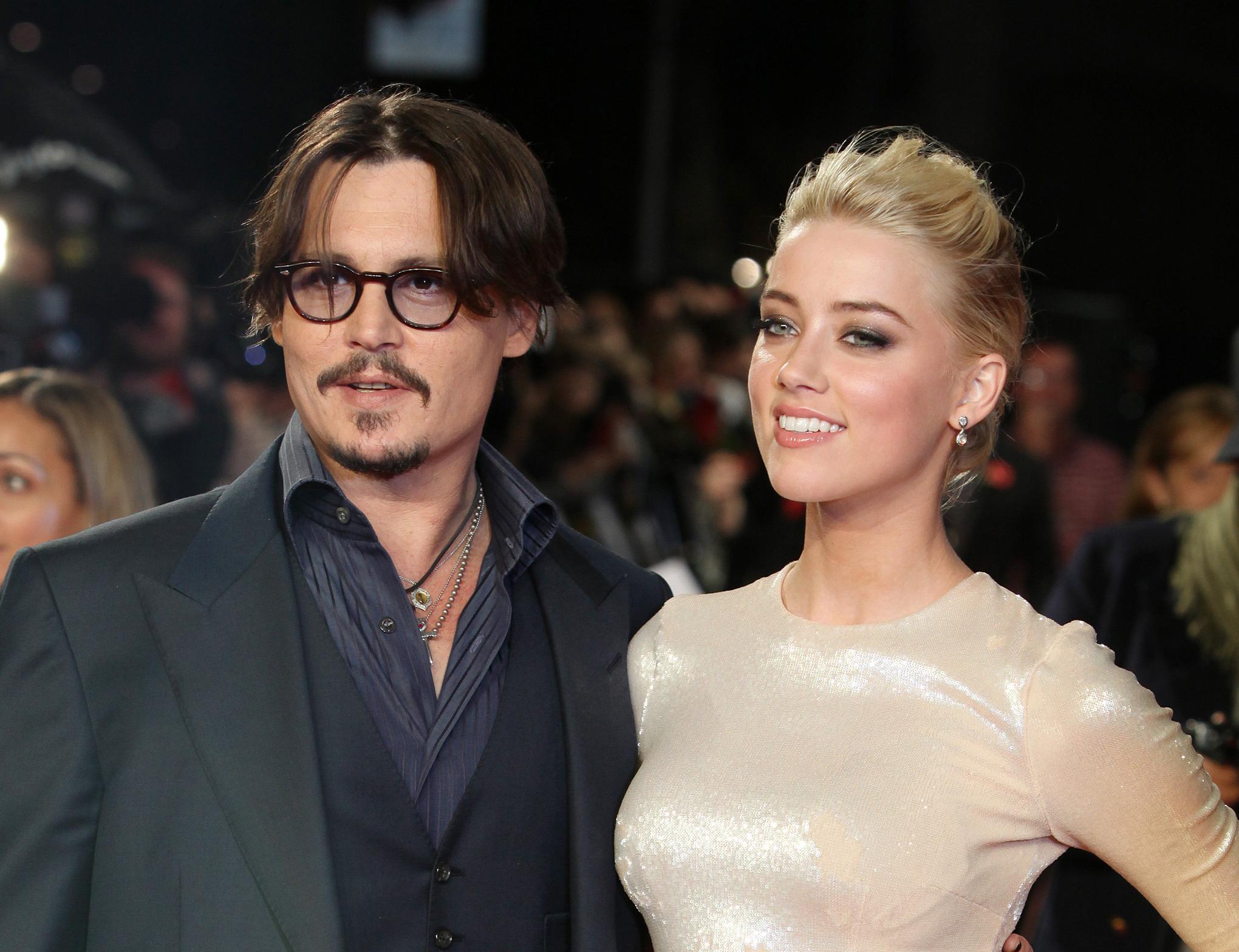 Johnny Depp and Amber Heard (AP Photo/Joel Ryan)