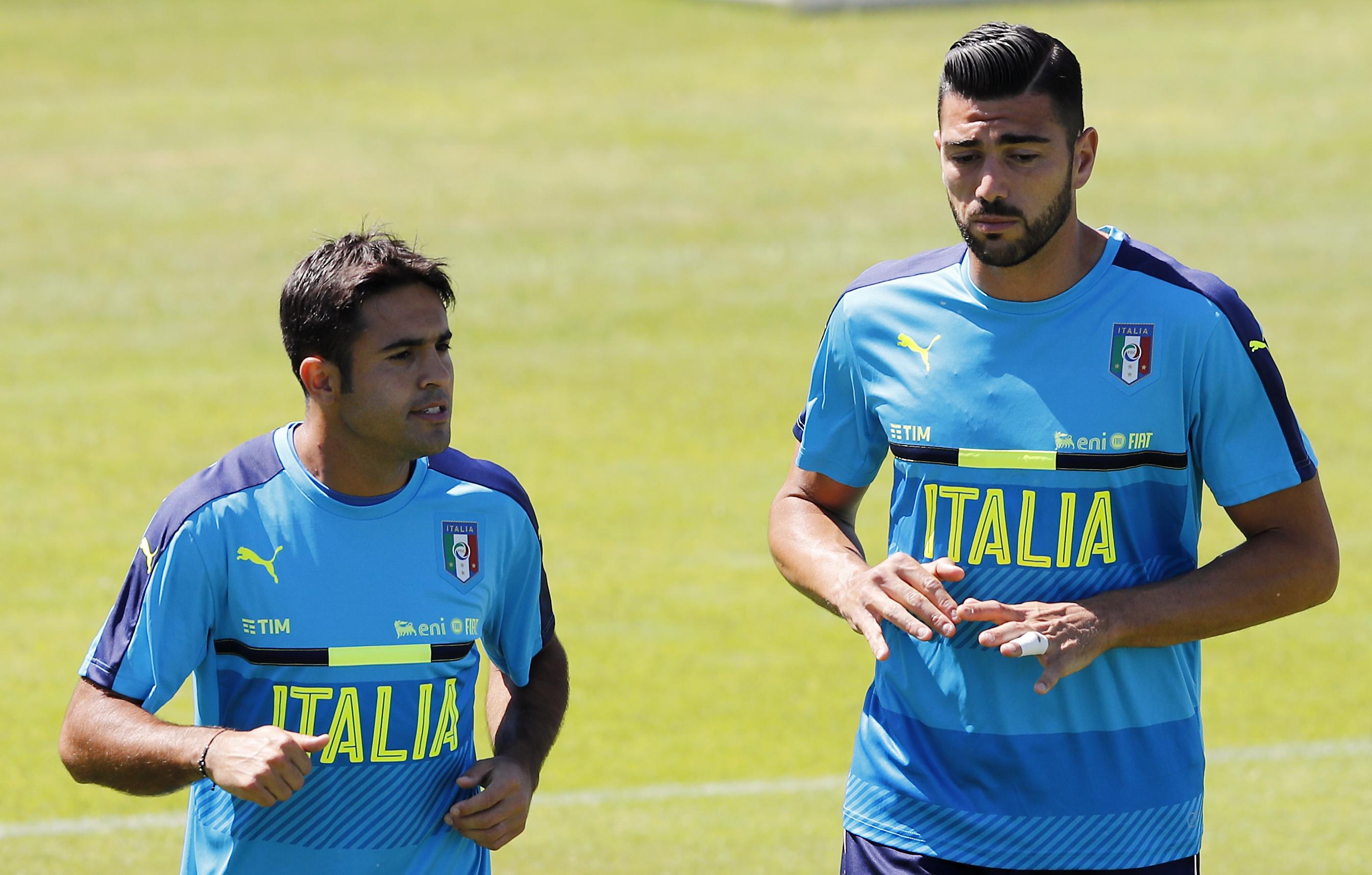 Italy's Eder, left, and Graziano Pelle (AP Photo/Antonio Calanni)