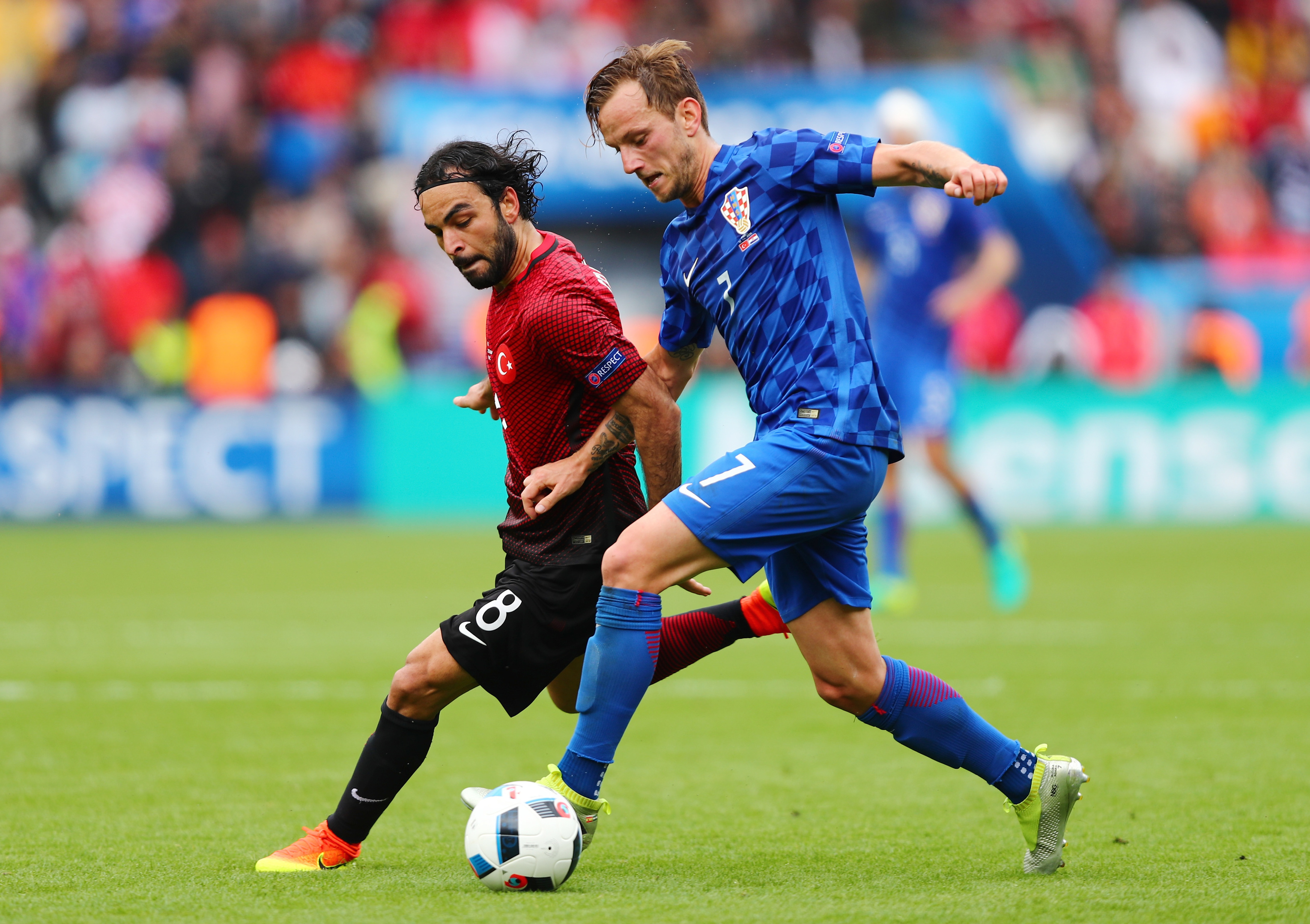 Ivan Rakitic of Croatia (in blue) and Selcuk Inan of Turkey compete for the ball during the UEFA EURO 2016 Group D match (Clive Rose/Getty Images)