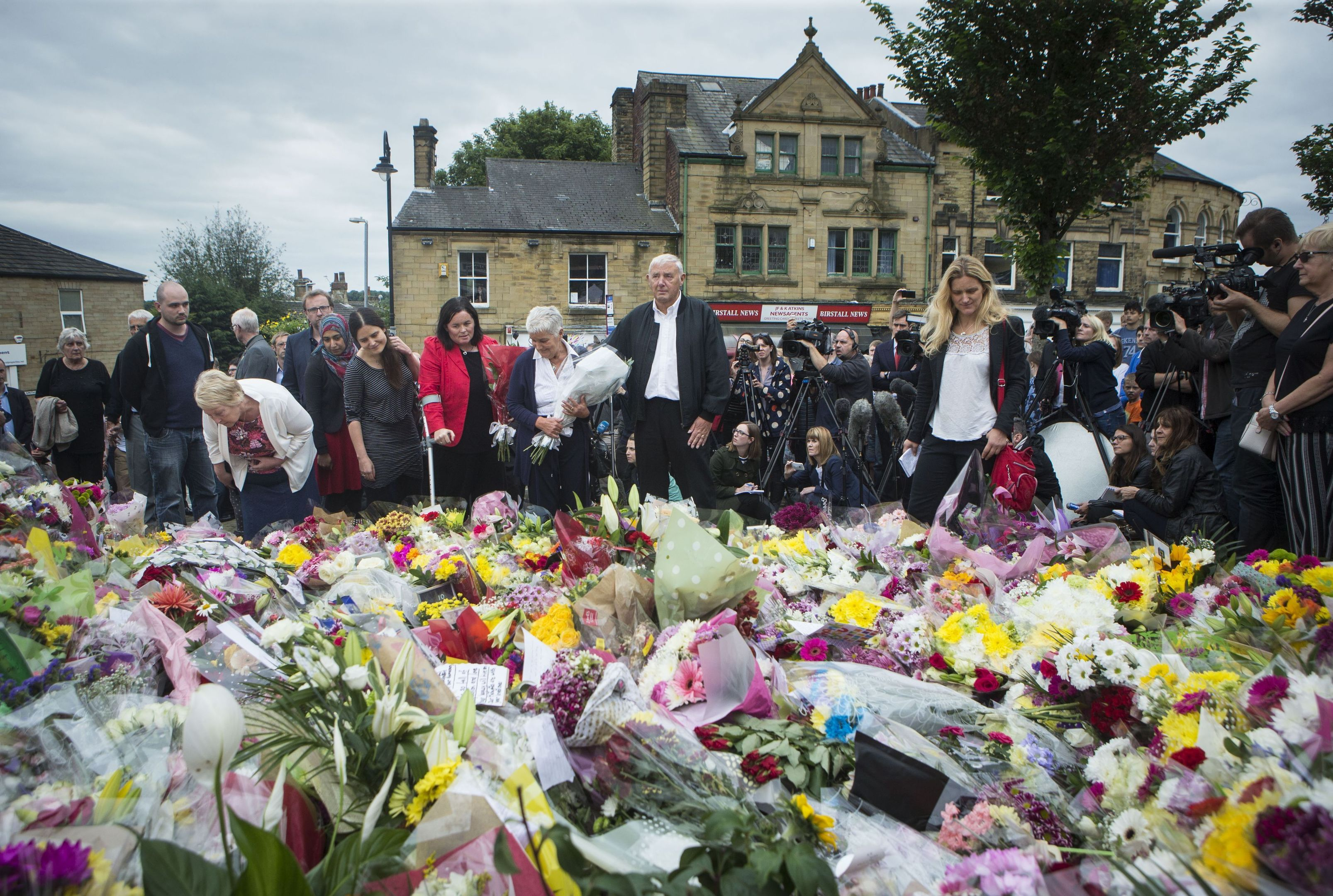 Kim Leadbeater (right), the sister of Labour MP Jo Cox, views floral tributes with her parents Jean and Gordon Leadbeater (centre) in Birstall, West Yorkshire (Danny Lawson/PA)