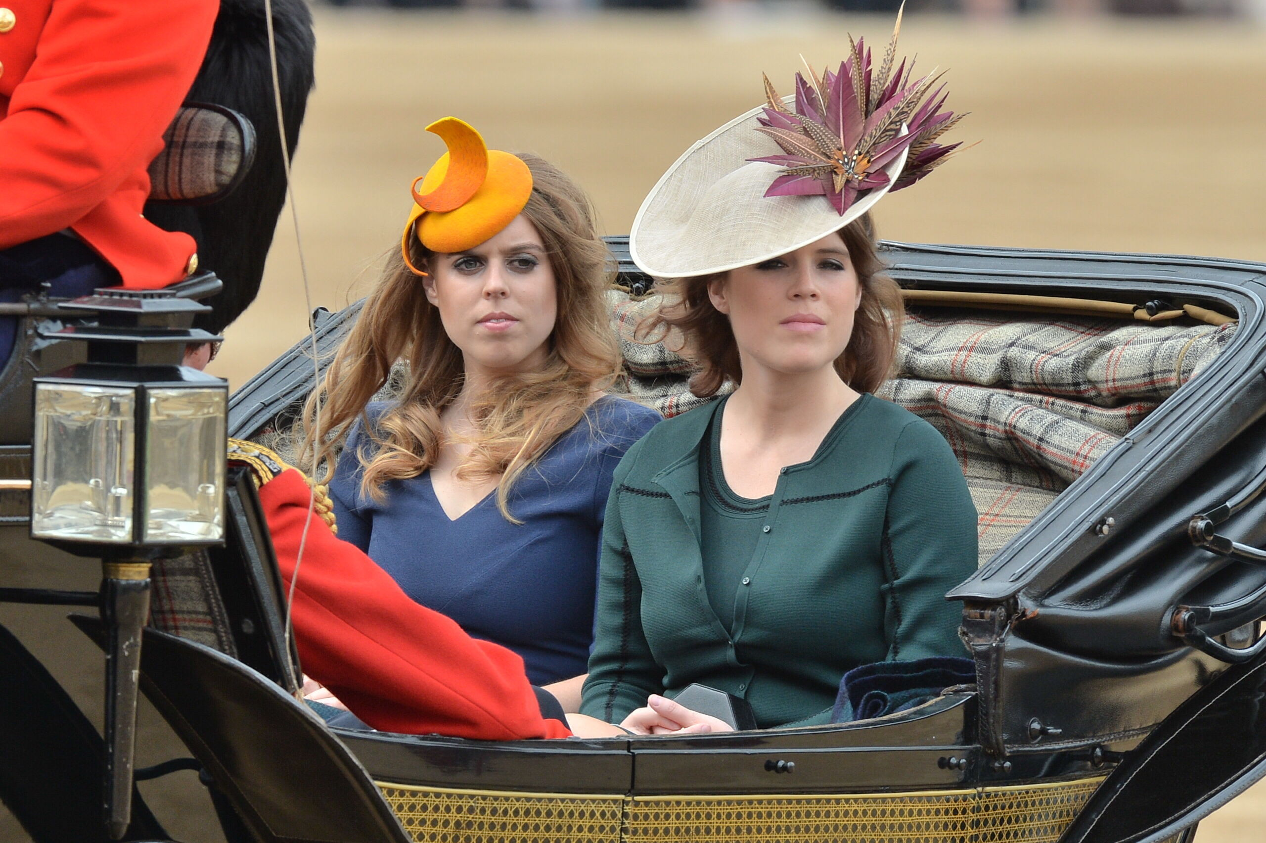 Princess Beatrice and Princess Eugenie (left) arrive in a carriage during the Trooping the Colour ceremony (John Stillwell/PA)