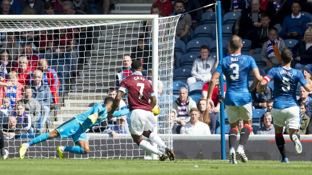 Burnley's Andre Gray (7) scores his side's second goal (SNS Group)