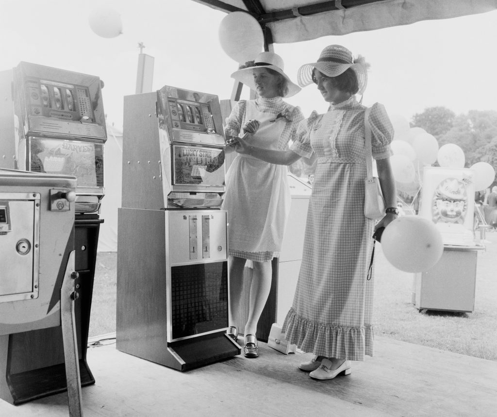 Fruit machines in an amusement marquee at Henley Royal Regatta, 1971 (William Vanderson/Fox Photos/Hulton Archive/Getty Images)