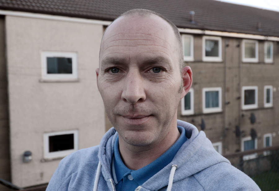 John Davis, aged 40, outside his home on Maple Road in Greenock, Inverclyde, who has been cleared of racially abusing his neighbour (Hemedia)