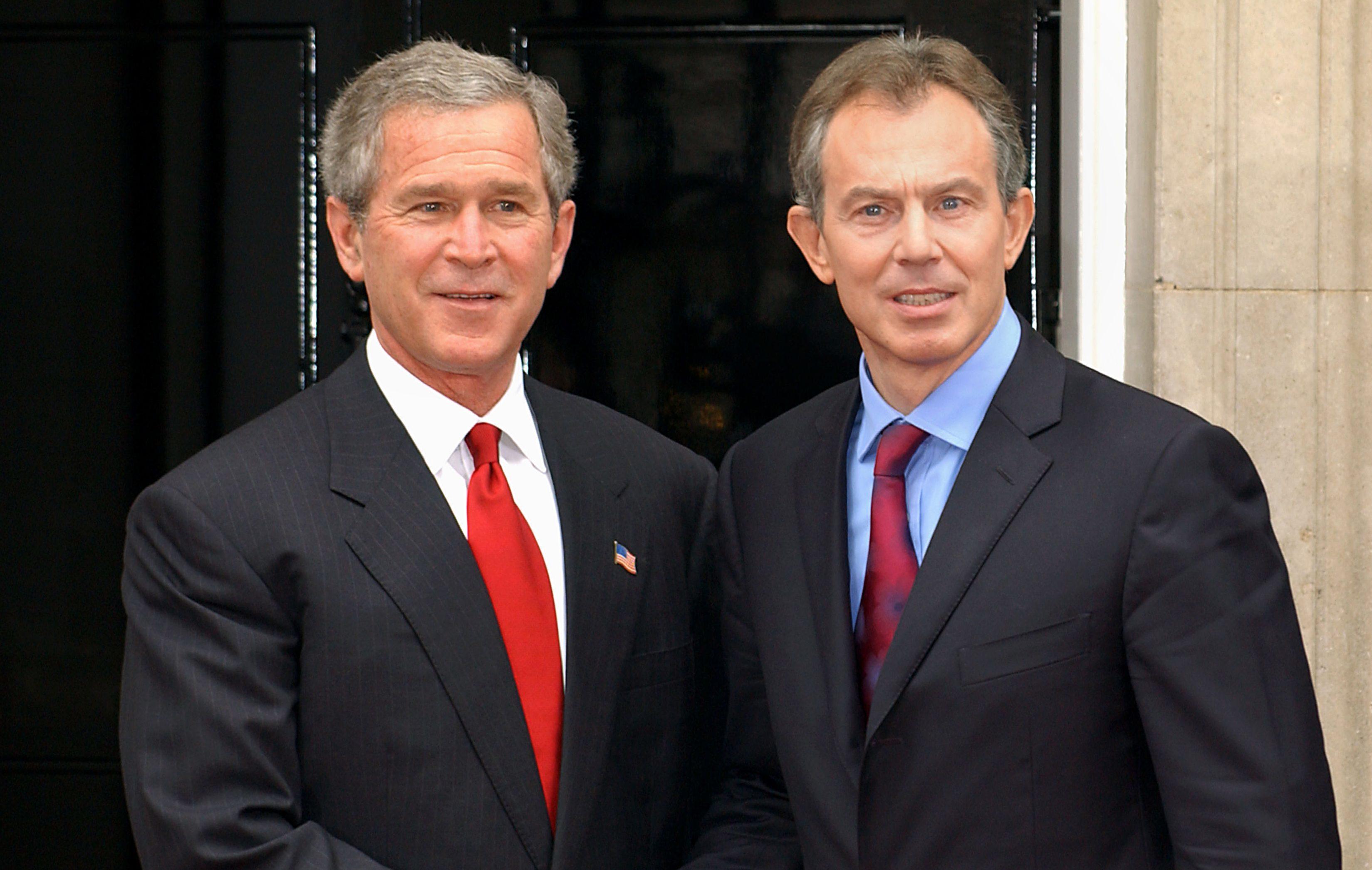Tony Blair (right) alongside former US President George Bush (Fiona Hanson/PA)