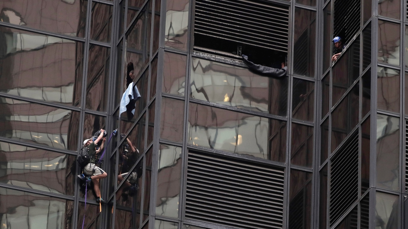A man scales the east side of Trump Tower using suction cups (AP Photo/Julie Jacobson)