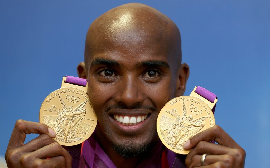 Mo Farah with his 2 Olympic gold medals (PA Archive)