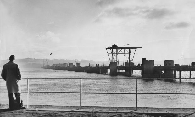 A man looks out onto the Tay Road Bridge Construction, 1963 (DC Thomson)
