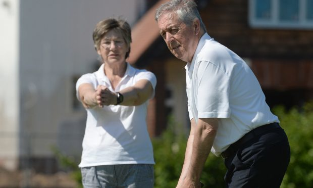 Blind golfer Gerry Kelly and his wife, caddie and guide Mary Kelly play some holes at Troon Welbeck Golf Club (James Chapelard / SWNS)