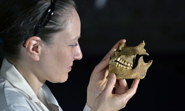 Dr Anwen Caffell of Durham University with some of the remains of a Scottish prisoner of war (Richard Rayner/Durham University/PA Wire)