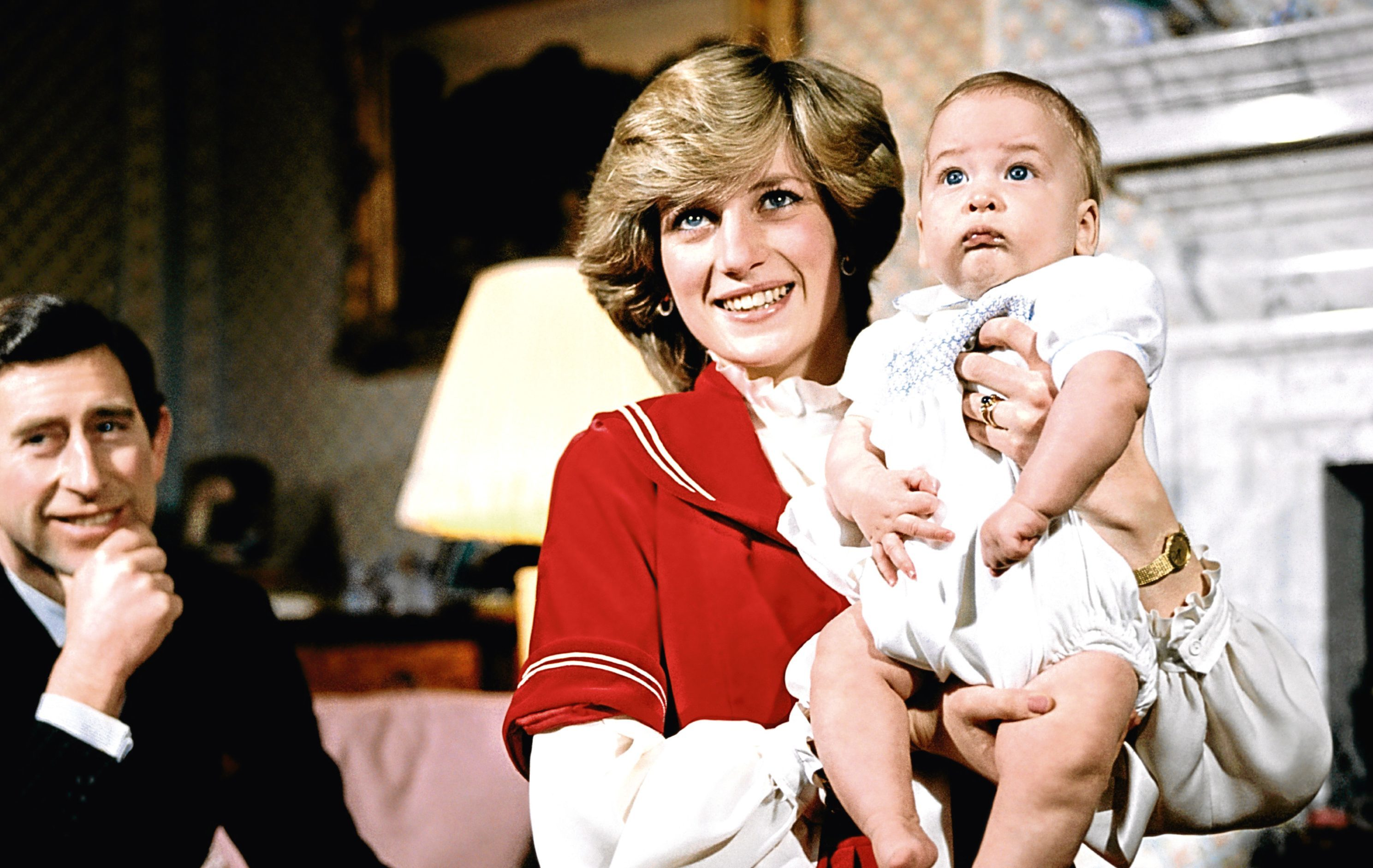 The Prince and Princess of Wales at Kensington Palace with baby son Prince William (PA Archive)