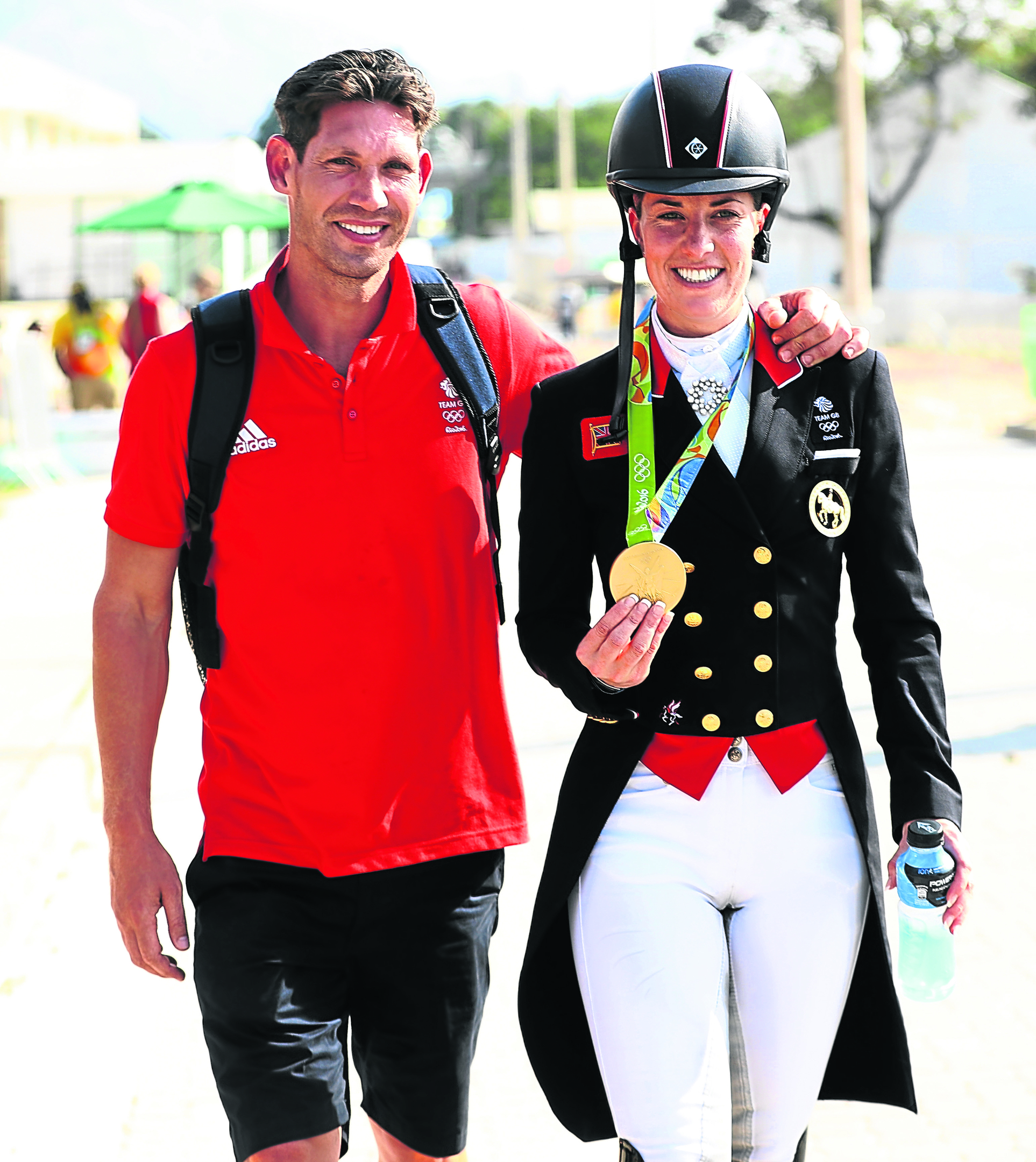 Charlotte Dujardin of Great Britain walks with her fiance, Dean Wyatt Golding after winning the gold medal during the Dressage Individual Grand Prix Freestyle (Photo by David Rogers/Getty Images)