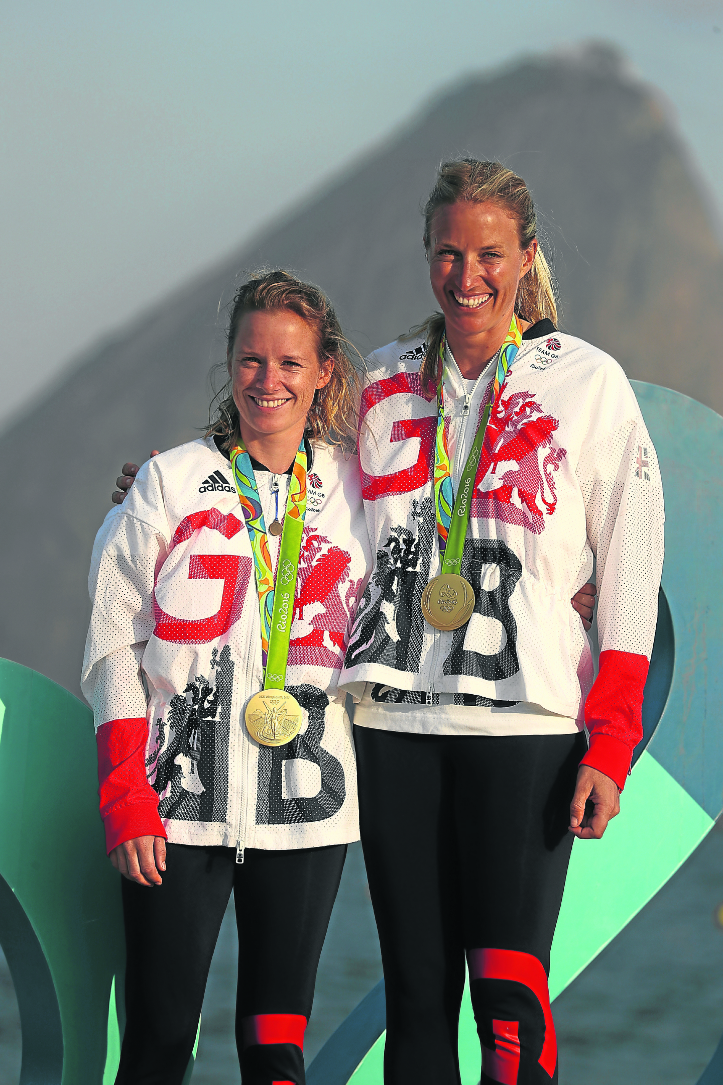 Hannah Mills of Great Britain (left) and Saskia Clark of Great Britain pose with their gold medals after winning the womens 470 class medal race at the Marina da Gloria (Photo by Clive Mason/Getty Images)