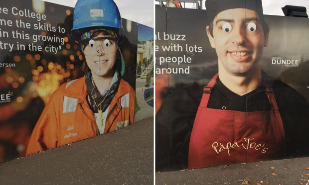 Two billboards surrounding a construction site at Dundee railway station  (Nicola Garrow/PA Wire)