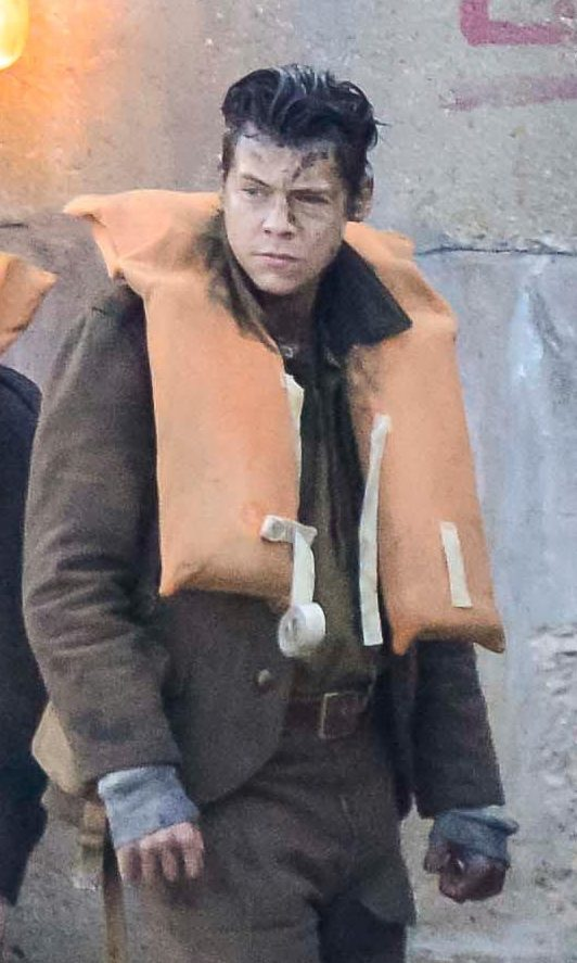 Harry Styles on a pontoon with extras dressed as soldiers during the filming of Dunkirk at Weymouth Harbour in Dorset (Graham Hunt/Alamy Live News)
