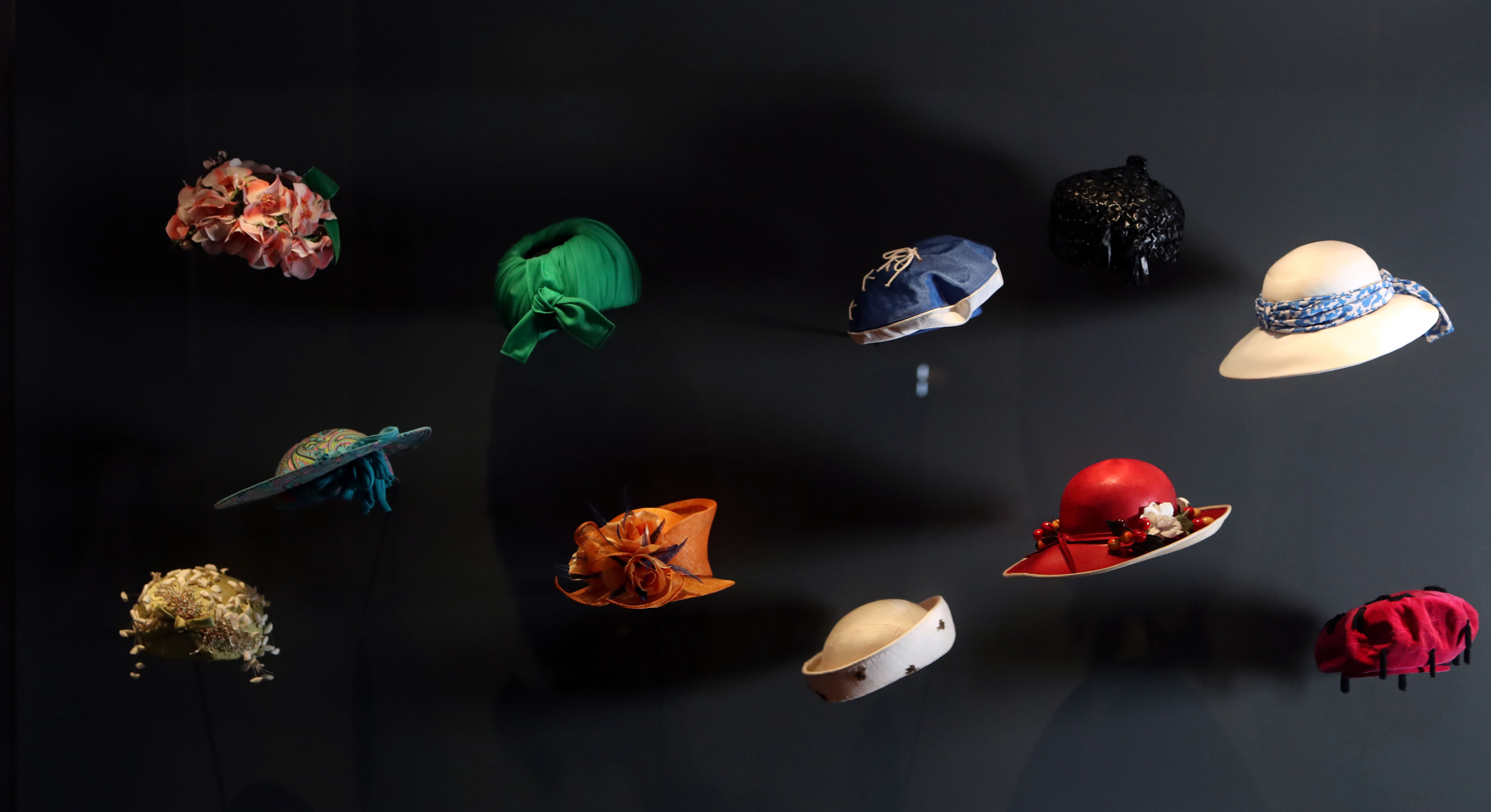 A selection of hats worn by The Queen, during a press preview for Fashioning a Reign: 90 Years of Style from the Queen's Wardrobe, an exhibition at Windsor Castle in Berkshire (Steve Parsons/PA)