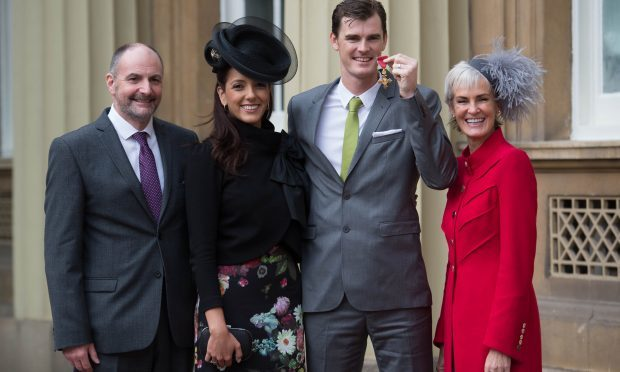 Jamie Murray with his wife Alejandra Gutierrez, mother Judy and father William (Stefan Rousseau - WPA Pool/Getty Images)