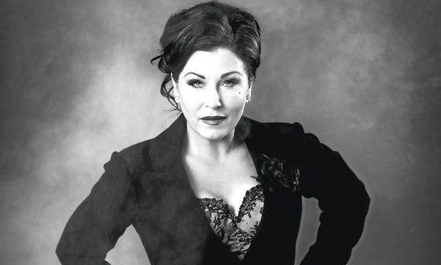 Jessie Wallace as 'Mama Morton'