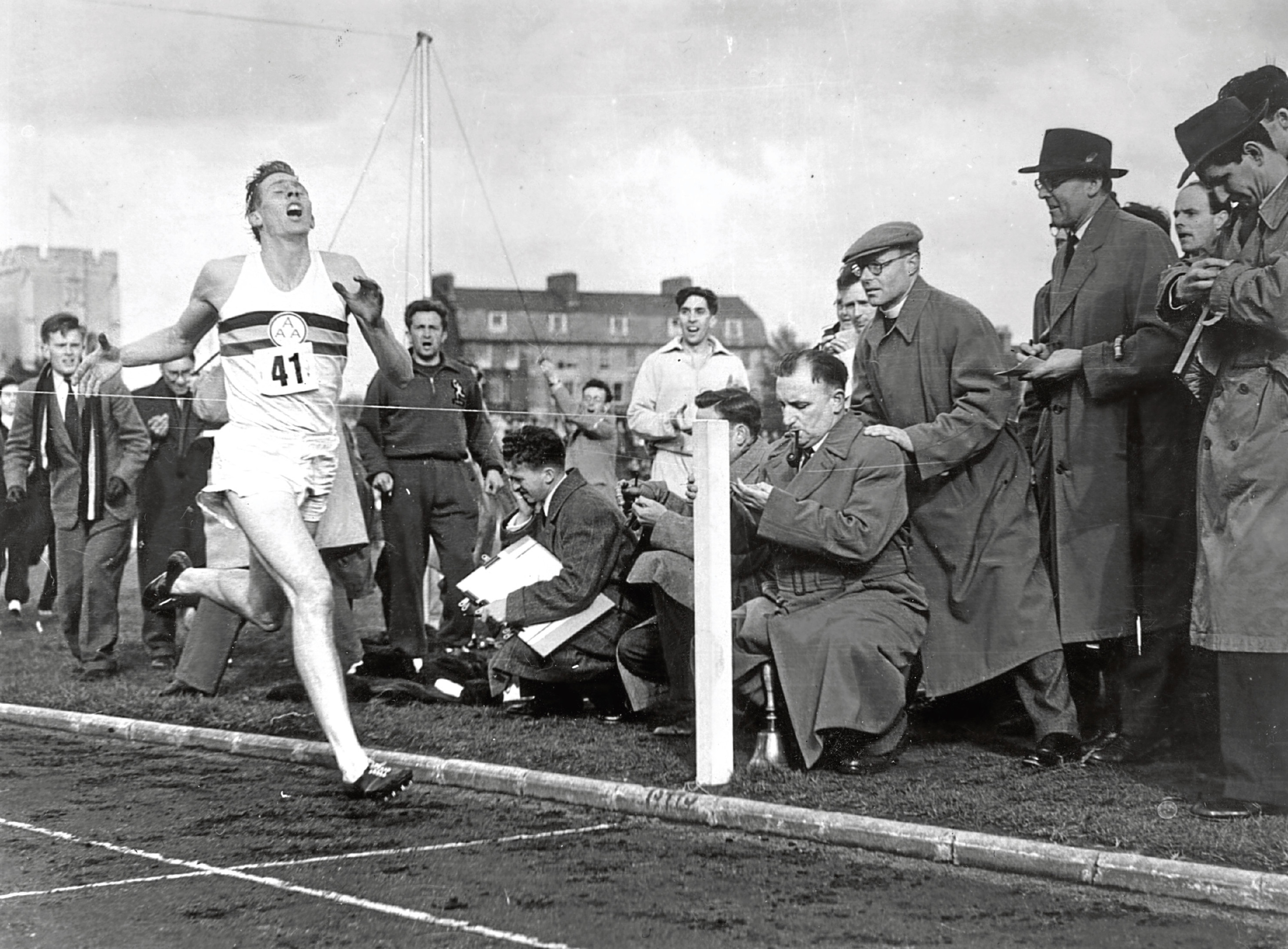 Roger Bannister about to cross the tape at the end of his record breaking mile run (Norman Potter/Central Press/Getty Images)
